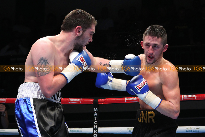 Michael O'Rourke (black shorts) defeats Danny Parsons during the 'Stand & Deliver' Boxing Show at York Hall, Bethnal Green