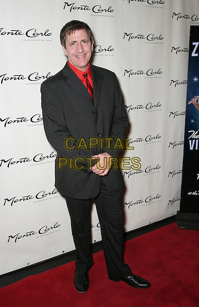 LOUIE PRIMA JR..Red Carpet Grand Opening for Zowie Bowie Vintage Vegas at the Monte Carlo Resort Hotel and Casino, Las Vegas, Nevada, USA..September 20th, 2009.full length black suit red.CAP/ADM/MJT.© MJT/AdMedia/Capital Pictures.