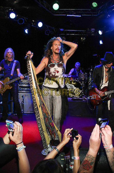 HOLLYWOOD, CA - APRIL 8: Steven Tyler of Aerosmith announce the Aerosmith &quot;Let Rock Rule&quot; North American summer tour at the Whisky A Go-Go in Hollywood, California on April 8, 2014. <br /> CAP/MPI/PGD<br /> &copy;PGDowling/Mediapunch/Capital Pictures
