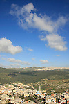 Israel, Jezreel valley. A view of Nazareth mountains from Mount Tabor, Arab village Daburiya at its foothill