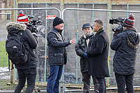 Pictured: John Brandler (C) with Ian Lewis (2nd L) and a camera crew from BBC's The One Show in Port Talbot. Friday 01 February 2019<br /> Re: Gallery owner and art collector John Brandler meets with garage owner Ian Lewis, where Banksy created his latest graffiti in Port Talbot, Wales, UK.