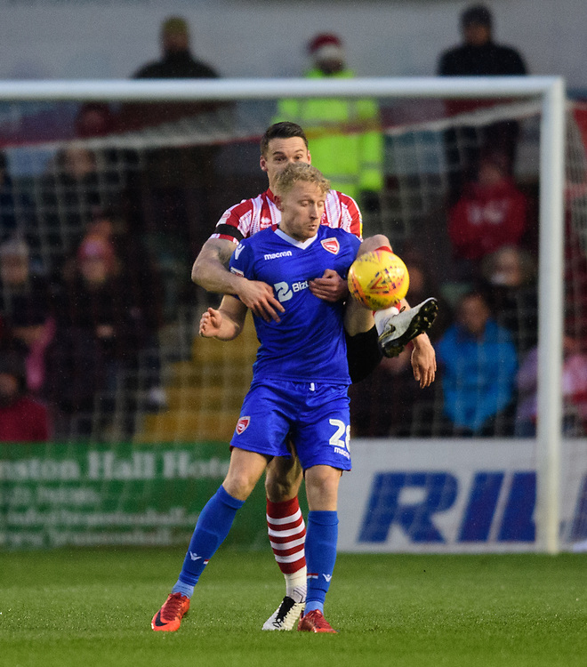 Morecambe's AJ Leitch-Smith shields the ball from Lincoln City's Jason Shackell<br /> <br /> Photographer Chris Vaughan/CameraSport<br /> <br /> The EFL Sky Bet League Two - Saturday 15th December 2018 - Lincoln City v Morecambe - Sincil Bank - Lincoln<br /> <br /> World Copyright © 2018 CameraSport. All rights reserved. 43 Linden Ave. Countesthorpe. Leicester. England. LE8 5PG - Tel: +44 (0) 116 277 4147 - admin@camerasport.com - www.camerasport.com