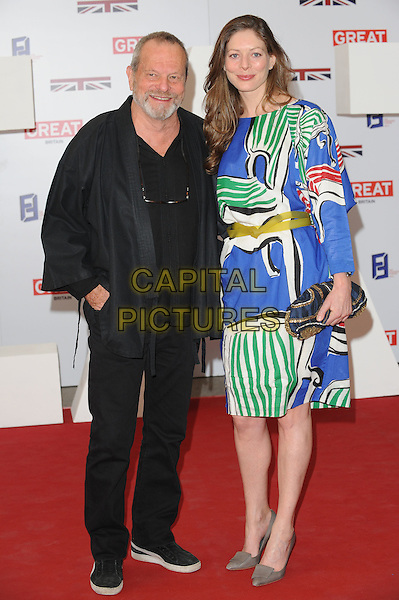 Terry & Amy Gilliam .The UK Creative Industries Reception supported by The Founders Forum, at the Royal Academy of Arts, London, as part of HM Government's GREAT campaign alongside the very best of the UK Creative Industries from the fields of music, film, art and entertainment..30th July 2012 .full length jacket trouser top green blue white yellow print dress married husband wife beard facial hair .CAP/BEL.©Tom Belcher/Capital Pictures.