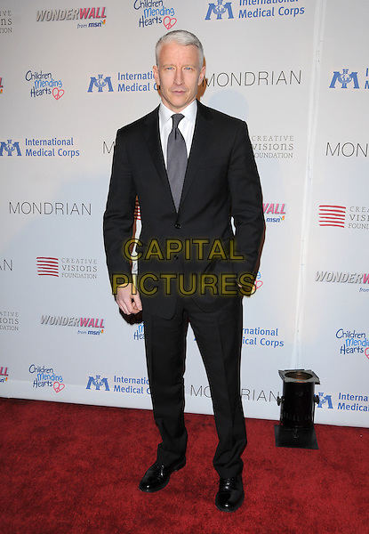 ANDERSON COOPER.The Children Mending Hearts Benefit for International Medical Corps Relief Efforts in the Congo held at The House of Blues Sunset in West Hollywood, California, USA..February 18th, 2009.full length black suit hand in pocket .CAP/DVS.©Debbie VanStory/Capital Pictures.