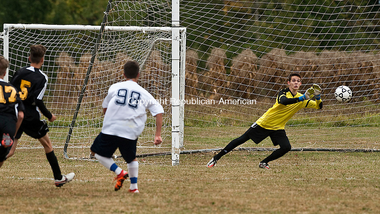 TORRINGTON, CT-092816JS07-  Wolcott Tech's Marc Rich (98) fires a shot past Kaynor Tech goal keeper Pierce Blom to tie the game a 1-1 during the first half of their  game Wednesday at Bishop Donnelly Field in Torrington. <br /> Jim Shannon Republican American