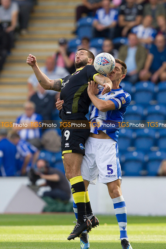 Luke Prosser of Colchester United gets to grips with Ollie Palmer of Crawley Town during Colchester United vs Crawley Town, Sky Bet EFL League 2 Football at the JobServe Community Stadium on 13th October 2018