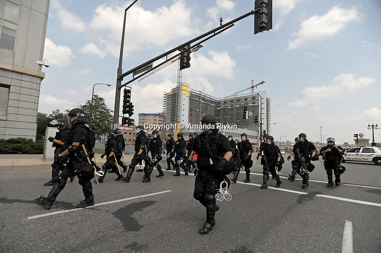 Police in riot gear respond as demonstrators shut down an intersection ias the Republican National Convention kicks off its first day of muted activities due to Hurricane Gustav in Saint Paul, Minnesota on September 1, 2008.