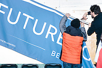 People take down banners after Vermont senator and Democratic presidential candidate Bernie Sanders speaks to senior citizens at the Peterborough Community Center gymnasium in Peterborough, New Hampshire.