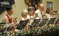 """NWA Media/Michael Woods --12/14/2014-- w @NWAMICHAELW...Members of the Village Handbell Ringers preform during Sunday afternoons Christmas Concert at the Bella Vista Community Church in Bella Vista.  The Bella Vista Mens Chorus presented """"I'm Dreaming of a Bella Vista Christmas"""" featuring classical, contemporary and gospel Christmas music under the direction of Bill Hesse and accompanied by Marilyn Lee on the piano. Also featured were the Village Handbell Ringers, under the direction of Marjorie Hemphill-Salomo and the Bella Vista Women's Chorus under the direction of Larry Zehring."""