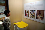 """A boy sees the Compostable Toilet at the Toilet!? Human Waste & Earth's Future exposition on August 1, 2014 in Tokyo, Japan. The Toilet!? Human Waste & Earth's Future is an exposition to listen the toilet's voice and explore what is the """"happy toilet"""" for each human being on the earth at National Museum of Emerging Science and Innovation in Tokyo from July 2 to October 5. The toilet is related not only to our daily life but also to the global environment. The exposition consist of eight areas where you can learn toilet problems for each generation and in the world. (Photo by Rodrigo Reyes Marin/AFLO)"""
