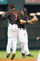 Jake Barrios #3 and Eric Gutierrez #12 of the Texas Tech Red Raiders celebrate their win over the Rice Owls at Minute Maid Park on March 2, 2014 in Houston, Texas.  The Red Raiders defeated the Owls 3-2 to finish the tournament 2-1.  (Brian Westerholt/Four Seam Images)