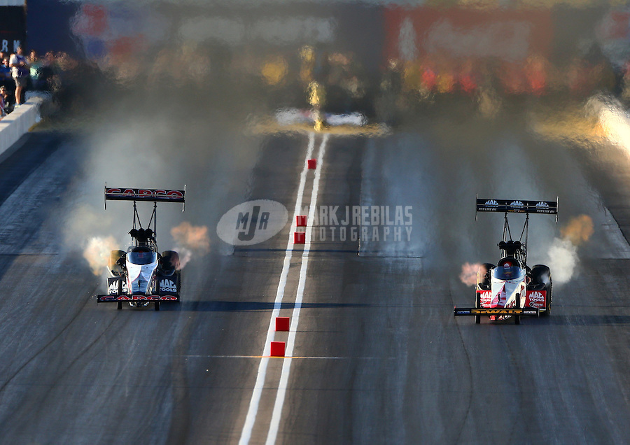 Feb 27, 2016; Chandler, AZ, USA; NHRA top fuel driver Steve Torrence (left) races alongside Doug Kalitta during qualifying for the Carquest Nationals at Wild Horse Pass Motorsports Park. Mandatory Credit: Mark J. Rebilas-