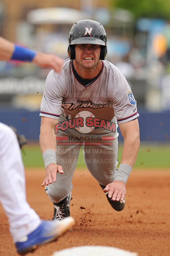 Northwest Arkansas Naturals Bubba Starling (6) slides into third base during the game against the Tulsa Drillers at Oneok Field on May 2, 2016 in Tulsa, Oklahoma.  Northwest Arkansas won 9-6.  (Dennis Hubbard/Four Seam Images)
