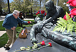 Rex T. Baggett, of Carson City, lays a flower on the memorial following the 21st annual Nevada State Law Enforcement Officers Memorial ceremony in Carson City, Nev., on Thursday, May 3, 2018. <br />