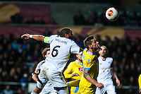 Swansea, UK. Thursday 20 February 2014<br /> Pictured: Ashley Williams heads the ball towards the Napoli goal<br /> Re: UEFA Europa League, Swansea City FC v SSC Napoli at the Liberty Stadium, south Wales, UK