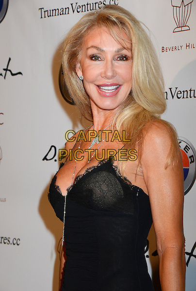 Linda Thompson.Mr. C Beverly Hills Hosts Domingo Zapata's Oscar Art Show at Mr. C Beverly Hills, California, USA..February 22nd, 2012.half length black dress lace .CAP/ADM/BT.©Birdie Thompson/AdMedia/Capital Pictures.