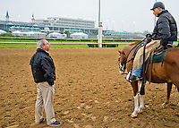 Shug McGaughey, trainer of probable Kentucky Derby favorite Orb,talks with D. Wayne Lukas at Churchill Downs during Derby Week April 29, 2013.