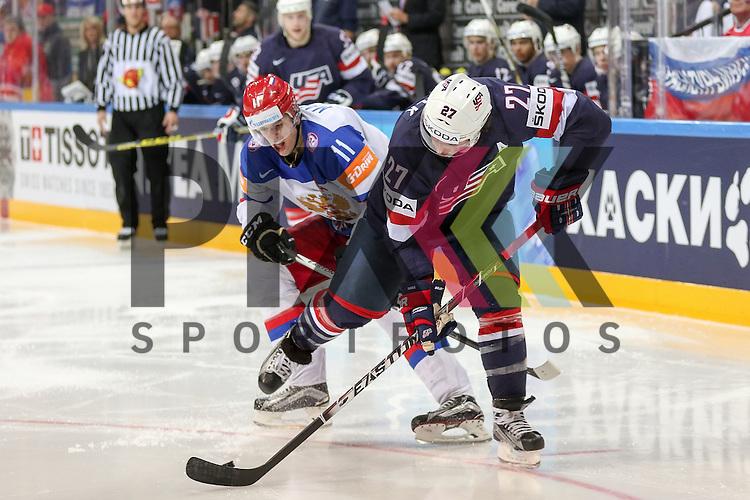 USAs Faulk, Justin (Nr.27)(Carolina Hurricanes) im Zweikampf mit Russlands Malkin, Yevgeni (Nr.11)(Pittsburgh Penguins)  im Spiel IIHF WC15 Russia vs. USA.<br /> <br /> Foto &copy; P-I-X.org *** Foto ist honorarpflichtig! *** Auf Anfrage in hoeherer Qualitaet/Aufloesung. Belegexemplar erbeten. Veroeffentlichung ausschliesslich fuer journalistisch-publizistische Zwecke. For editorial use only.