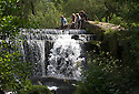 22/07/14 <br /> <br /> People cool off by Monsal Weir, near Bakewell in the Derbyshire Peak District.<br /> <br /> All Rights Reserved - F Stop Press.  www.fstoppress.com. Tel: +44 (0)1335 300098