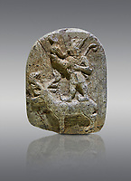 Plaque depicting the Hittite Protector of the wild standing on the back of a deer. Steatite - 14th - 13th century BC - Corum Yenikoy  - Museum of Anatolian Civilisations, Ankara, Turkey, Against a grey  background