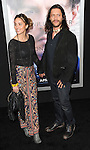 Clifton Collins Jr. and Megan Ozurovich arriving at the Transcendence Los Angeles Premiere held at the Regency Village Theater April 10, 2014.
