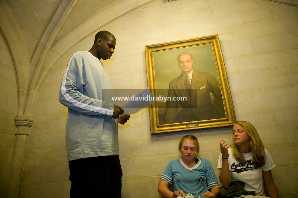 Eric Boateng (L) talks to schoolmates in a hall at St Andrews High School in Middletown, DE, United States, 19 April 2005.