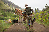 USA, Oregon, Joseph, Cowboy Cody Ross coils his rope after working on a calf in the canyon up Big Sheep Creek in Northeast Oregon