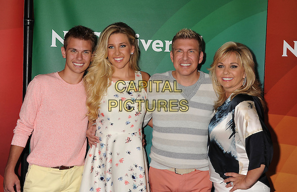 BEVERLY HILLS, CA- JULY 14: (L-R) TV personalities Chase Chrisley, Savannah Chrisley, Todd Chrisley and Julie Chrisley attend the 2014 Television Critics Association Summer Press Tour - NBCUniversal - Day 2 held at the Beverly Hilton Hotel on July 14, 2014 in Beverly Hills, California.<br /> CAP/ROT/TM<br /> &copy;Tony Michaels/Roth Stock/Capital Pictures