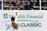 WATERLOO, ON - JUNE 8: Belen Mozo of Spain throws golf balls into the crowd on the 18th green after the final round of the Manulife Financial LPGA Classic at the Grey Silo Golf Course on June 8, 2014 in Waterloo, Ontario, Canada. (Photo by Steve Dykes/Getty Images) *** Local Caption *** Belen Mozo