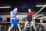 Abbeyfeale Boxing Club held its 1st. Tournament last Sunday in their club house Anthony Walsh Castleisland (Blue)&amp; Mich&eacute;al Roche Abbeyfeale( black) battle it out in the ring .<br /> .