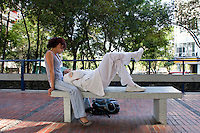A couple relax at the medical faculty in the Mexico City campus (Ciudad Universitario) of the UNAM (Universidad Autonomo de Mexico) Mexico City. June 20, 2008
