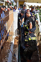 Pictured: Firefighters retrieve the body of an elderly woman from her flooded basement flat in Messini, near the town of Kalamata, Messinia, Greece. Wednesday 07 September 2016<br /> Re: Severe flash flooding has affected parts of Messinia County in southern Greece.