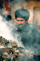 Shortly after arriving in the ancient city of Kashgar, I wandered the narrow allies around the Id Kah Mosque exploring the eclectic shops and kiosks. The sweet smoky odor of seared mutton and cumin saturated the bitter cold air.