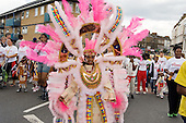 Flamboyan mas band parade during children's day at Notting Hill Carnival