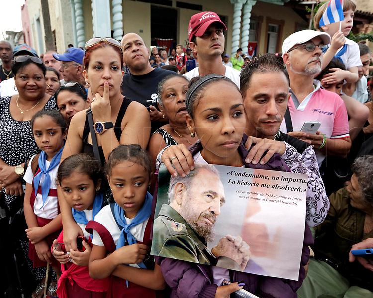 Cubans wait for the passage of Fidel Castro's ashes in Santa Clara, Cuba on Thursday, December 1, 2016