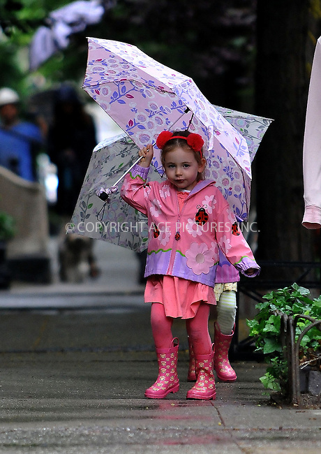 WWW.ACEPIXS.COM......May 28 2013, New York City....Twins Marion and Tabitha Broderick walk home from school in the rain on May 28 2013 in New York City......By Line: Romeo/ACE Pictures......ACE Pictures, Inc...tel: 646 769 0430..Email: info@acepixs.com..www.acepixs.com
