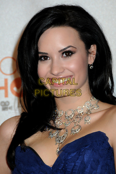 DEMI LOVATO.Pressroom at the 36th Annual People's Choice Awards held at the Nokia Theatre LA Live, Los Angeles, California, USA..January 6th, 2010.press room headshot portrait necklace cleavage blue strapless .CAP/RKE/DVS.©DVS/RockinExposures/Capital Pictures.