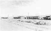 View of D&amp;RGW Hooper station area looking northeast.  Depot - SG reefers on sidings - freight departing north to Salida.<br /> D&amp;RGW  Hooper, CO  Taken by Richardson, Robert W. - 11/1950