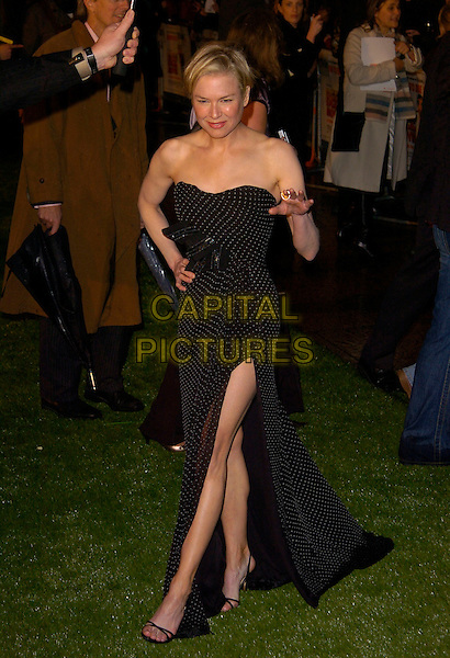 "RENEE ZELLWEGER.UK Premiere of ""Bee Movie"" held at the Empire, Leicester Square, London, England. .December 6th, 2007.full length black white strapless polka dot dress slit split hand on hip hand.CAP/CAN.©Can Nguyen/Capital Pictures"