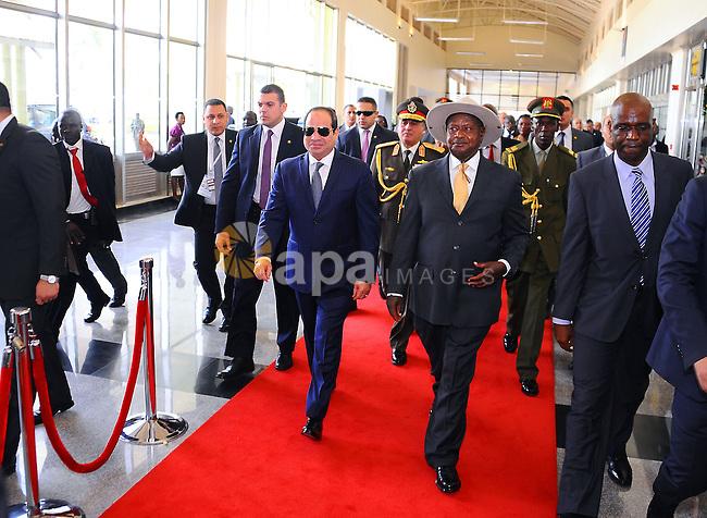 Egyptian President Abdel Fattah al-Sisi walks alongside Ugandan President Yoweri Museveni during his visit to Ugandan capital Kampala, on December 18, 2016. Photo by Egyptian President Office
