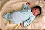 young infant girl sleeping on bed