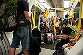 London, UK. 28 August 2017. On the Tube to the Carnival. Notting Hill Carnival celebrations and parade on Bank Holiday Monday. The festival attacts over 1 million visitors and in 2017  it remembers the victims of the Grenfell Tower fire.