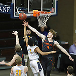 SIOUX FALLS, SD - MARCH 9:  Mitch Morken #4 of Indiana Tech blocks the shot of Wes Stowers #4 of Marian at the 2018 NAIA DII Men's Basketball Championship at the Sanford Pentagon in Sioux Falls. (Photo by Dick Carlson/Inertia)