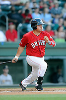 First baseman Francisco Tellez (48) of the Greenville Drive bats in a game against the Charleston RiverDogs on Saturday, May 23, 2015, at Fluor Field at the West End in Greenville, South Carolina. Charleston won 5-4. (Tom Priddy/Four Seam Images)