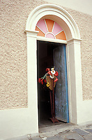 Artificial flowers in the doorway of a handicrafts store in the Spanish colonial town of Todos Santos , Baja California Sur, Mexico