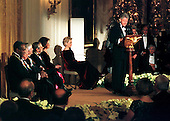 1998 Kennedy Center honorees listen to United States President Bill Clinton's remarks in their honor in the East Room of the White House in Washington, D.C. on December 6, 1998.  Seated (L-R) Bill Cosby, John Kander, Fred Ebb, Andre Previn, and Shirley Temple Black.  (Willie Nelson is not visible)..Credit: Ron Sachs -  CNP