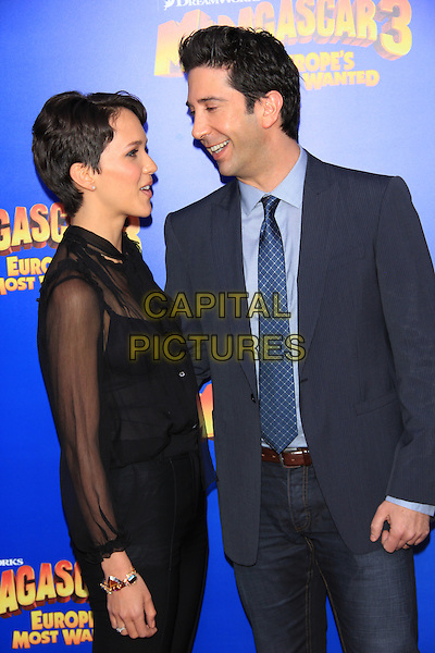 "Zoe Buckman & David Schwimmer.The New York Premiere of ""Madagascar 3: Europe's Most Wanted"" held at Ziegfeld Theater, New York, NY, USA..June 7th, 2012.half length suit blue tie black trousers sheer blouse married husband wife profile smiling .CAP/LNC/TOM.©LNC/Capital Pictures."