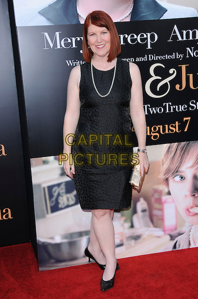 "KATE FLANNERY .at The Columbia Pictures' Screening of  ""Julie & Julia"" held at The Mann's Village Theatre in Westwood, California, USA, July 27th 2009.                                                                   .full length black sleeveless shift dress necklace shoes pearl necklace pearls clutch bag .CAP/DVS.©Debbie VanStory/RockinExposures/Capital Pictures"