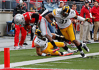 Iowa Hawkeyes linebacker Anthony Hitchens (31) knocks Ohio State Buckeyes running back Dontre Wilson (1) out of bounds just before the goal line in the third quarter of the NCAA football game between the Ohio State Buckeyes and the Iowa Hawkeyes at Ohio Stadium in Columbus, Saturday afternoon, October 19, 2013. The Ohio State Buckeyes defeated the Iowa Hawkeyes 34 - 24.  (The Columbus Dispatch / Eamon Queeney)