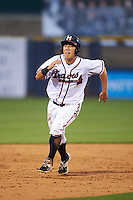 Mississippi Braves outfielder KD Kang (12) running the bases during a game against the Pensacola Blue Wahoos on May 27, 2015 at Trustmark Park in Pearl, Mississippi.  Pensacola defeated Mississippi 7-5 in fourteen innings.  (Mike Janes/Four Seam Images)